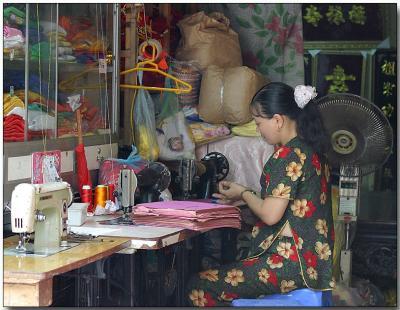 Sidewalk seamstress