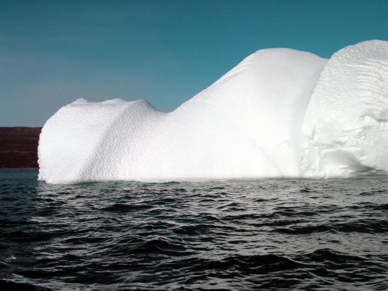 Dark Blue Water with Iceberg