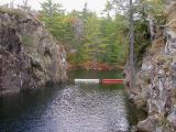 Granite cliffs at mouth of spillway near locks
