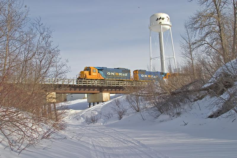 Engines take freight section across Store Creek bridge before hooking up to passenger section