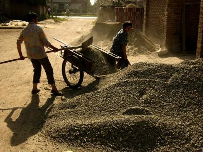 Shoveling gravel outside of Xian, China, 2004