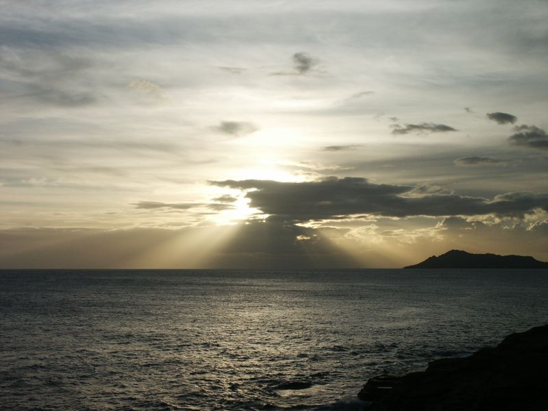 Muted sunset off Diamond Head from Spitting Caves (Portlock)