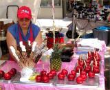 Candy apple vendor at 6th ave street fair