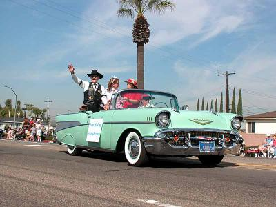 Silverado Sam greeting the crowd in a 1957 Chevy Converible