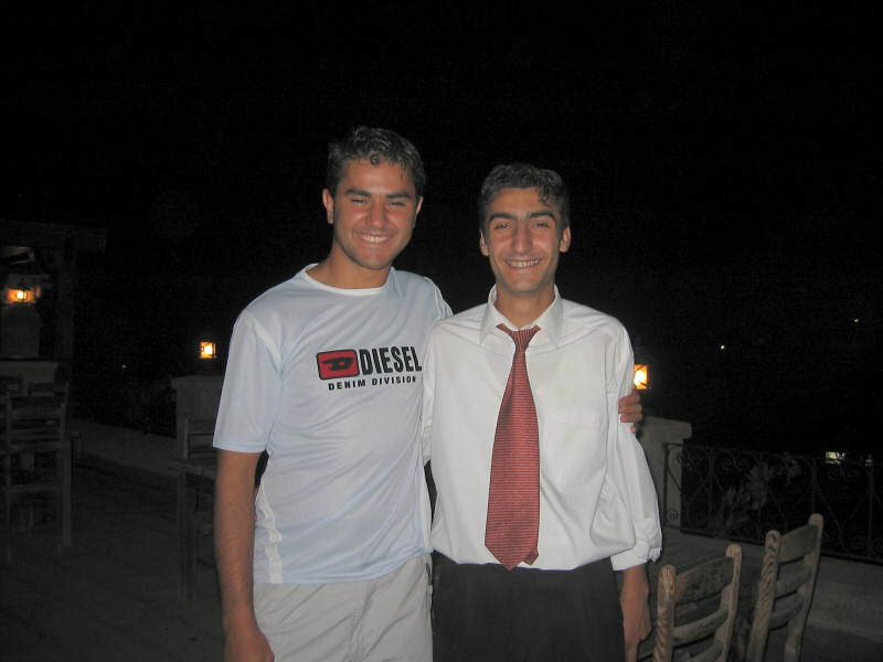Yilmaz (red tie) from Yusuf Pasa Hotel and<br> his cousin from France