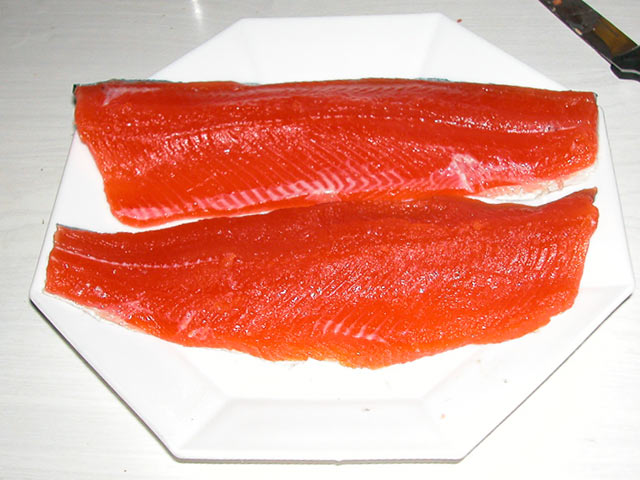 Filleted trout on white plate