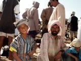 Omani boy with father, Barka fish market