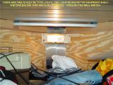 THE 12 VOLT LIGHT SHOWN HERE IS LOCATED ABOVE THE ACCESSORY SHELF AND THERE IS ANOTHER ONE BELOW THE SHELF