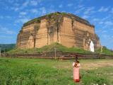 A nun poses in front of Mingun Paya.