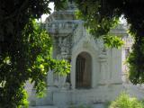 Sandamani Paya. The marble slabs inside contain commentaries on the Tripitaka.