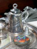 hand-painted rock on silver platter