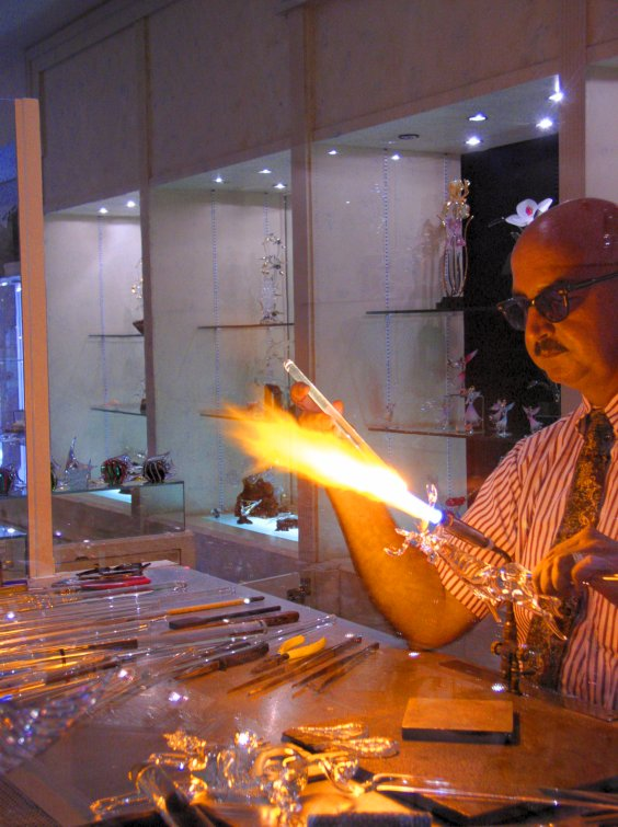 Artist working on glass sculpture