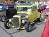 yellow five window coupe