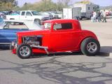 beautiful orange fenderless  Ford 3 window coupe