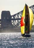 Yacht heading for Harbour Bridge and naval vessel