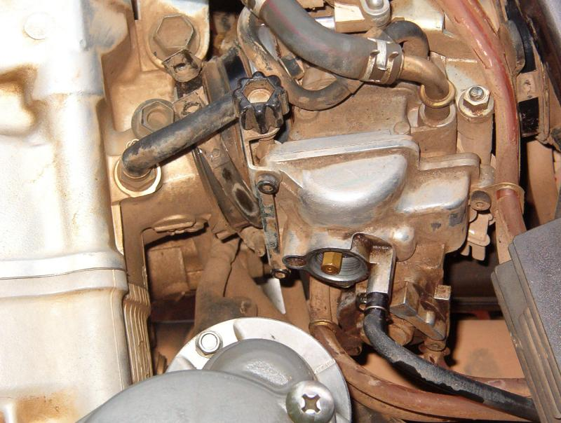 Carburetor main jet and fuel screw access