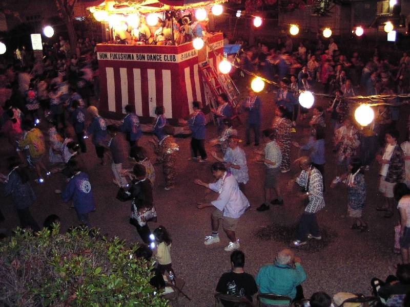 Obon dancers circle in unison