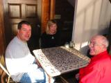 Greg Rachel and Grandpa working the puzzle