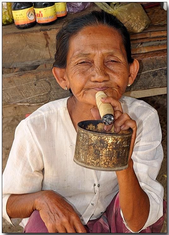 Smoking a cheroot - Phwassaw village , Bagan