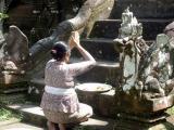 Balinese lady praying at temple steps, Mengening