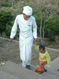 Holy man and child, Ulawatu