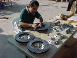 Armando instaling the hats on the rotors