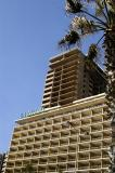 Carlton Hotel with an unrestored highrise