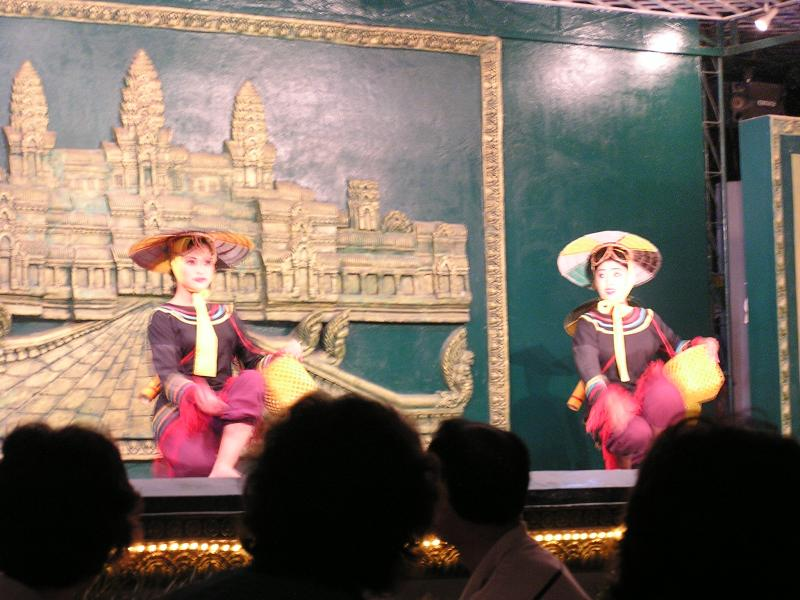 Dancers enacting traditional rice farming