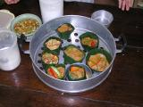 Fish soufle in banana leaf (D's is the one in the lifeboat cuz it sprung a leak)