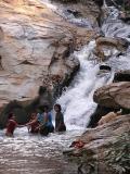 Kids and pooch at play at waterfall