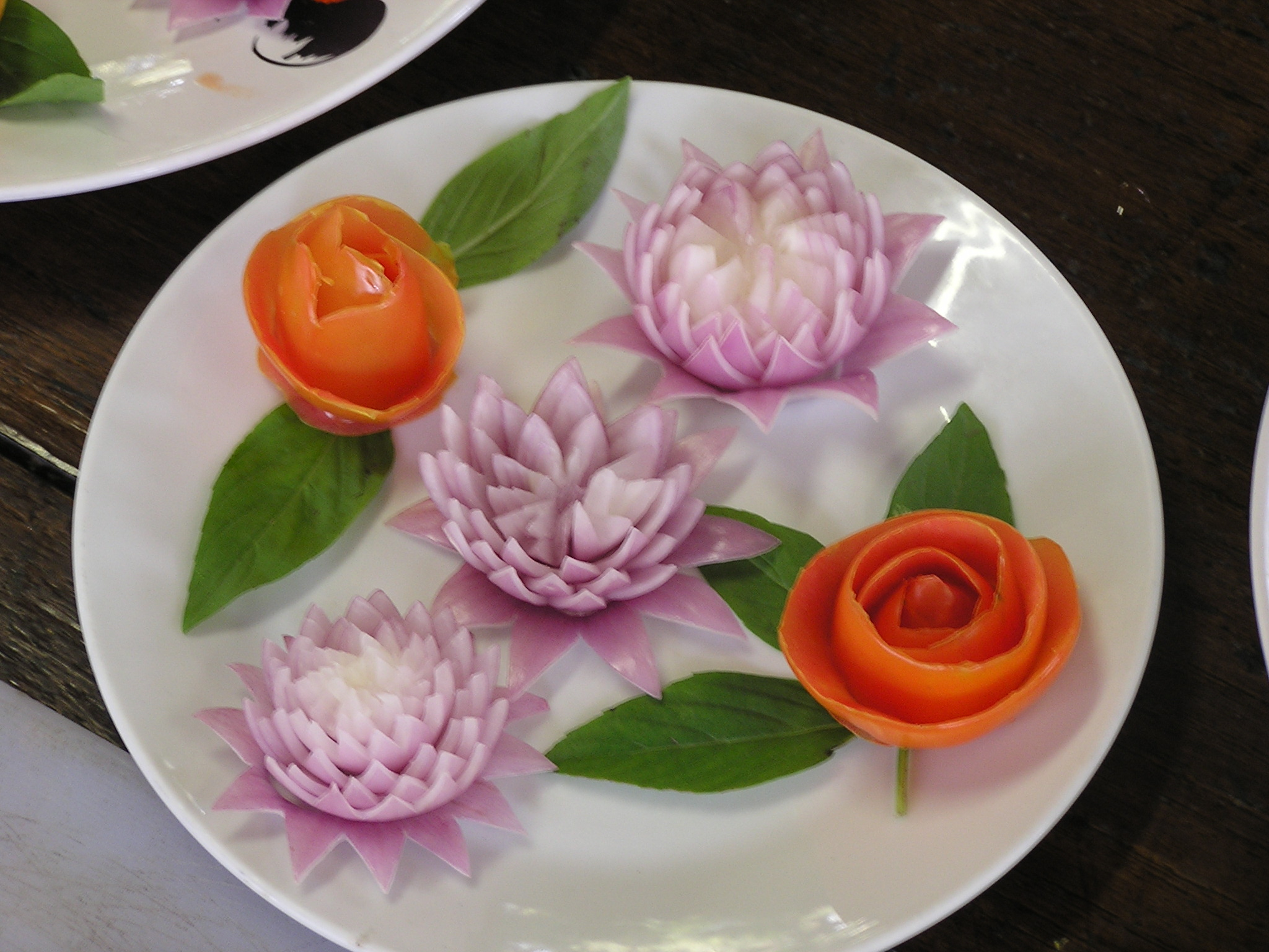 Lotus flowers of onion and roses of tomato peel (m not so good at this)