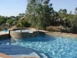 The pool that my son built...he did all the tile brick  and stone work on and around it...