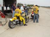 FILLING UP THE BIKE WITH SUNOCO RACING GAS, DON'T ASK THEM WHAT KIND OF MILEAGE THEY GET, AS THEY WILL JUST LAUGH