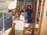 TERRY FEEDS THE HUNGRY CREW INCLUDING BUDDY ON THE FLOOR