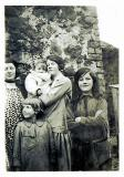 L-R Aunt May, Edna Campbell holding baby Claire, Maisie Cummings. Front Jim Campbell