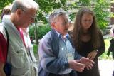 Reuven Monowitz recounting a history in Hebrew, flanked by Ian & our guide Regina Kopilevich
