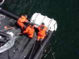 Move liferaft canister into position