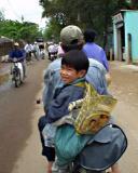Smiling Kid on Moto in Hue