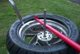 Next I get the edge of the tire started and use a tire iron to hold on position
