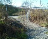 Chain Link fence breached to cross the RR tracks