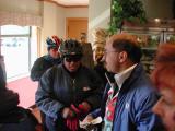 Alfredo Garcia (blue jacket) settling up with the cashier after our pancake brunch