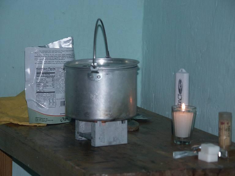 2371 Esbit tablet stove at work in hotel room.jpg