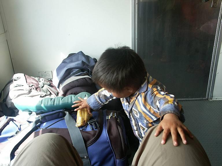 2743 Indian boy checking the gringos stuff.jpg