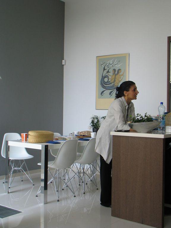 Maria in kitchen/diner