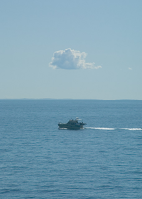 A solitary cloud, a solitary boat