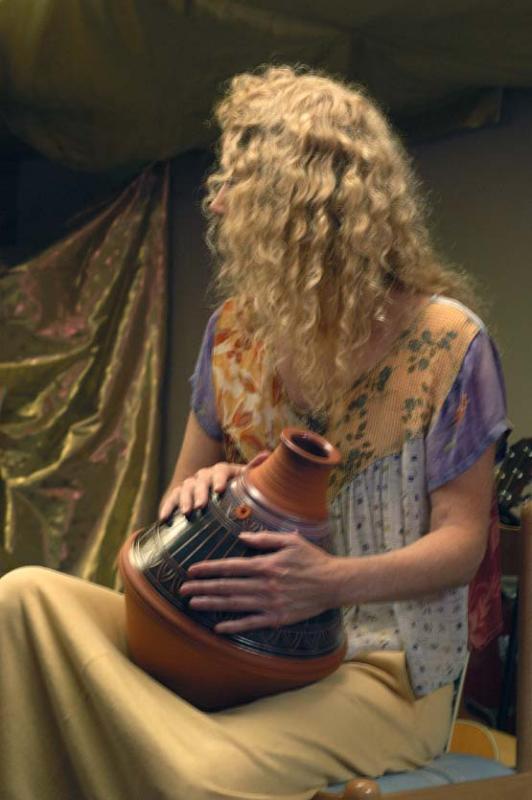 Jennie playing ceramic drum