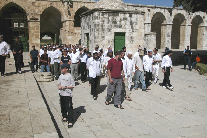 A group of Jewish visitors enter the Mount.