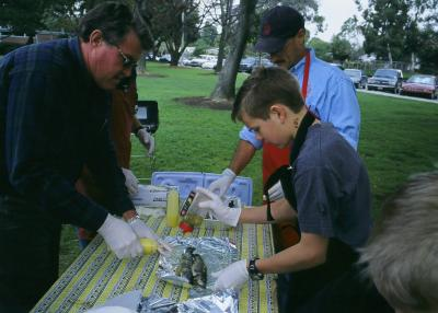 Mr. Moosman and Alex wrapping the fish