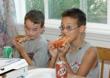 Sam & Mckade eating pizza