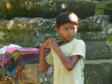 Little boy sneaks into the temple to sell